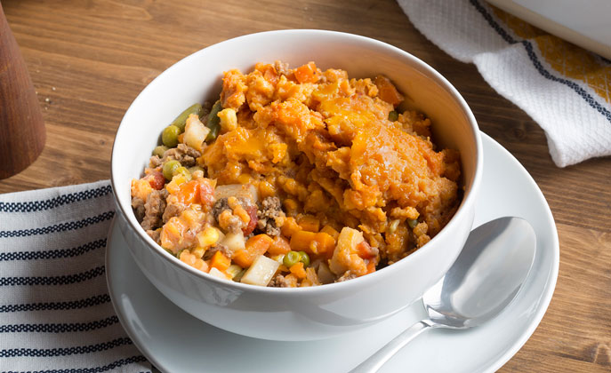 Sweet potatoes add a colorful twist to shepherd's pie full of veggies and your choice of ground beef or leftover roasted turkey or chicken.